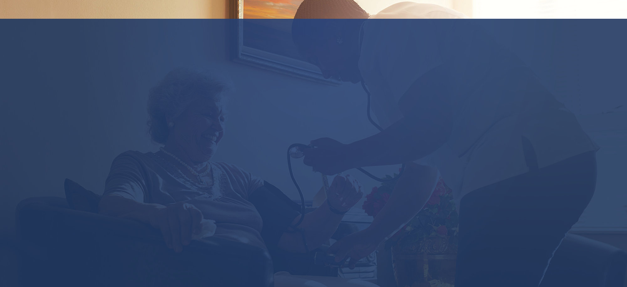 caregiver monitoring the patient's blood pressure