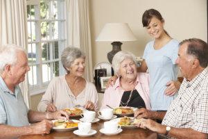 caregiver preparing meals for the senior patients