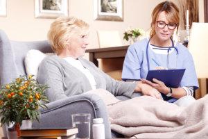 nurse recording the patients medical status