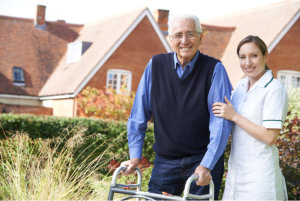 caregiver assisting the senior patient in walking