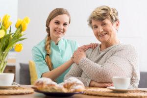 caregiver comforting the senior patient